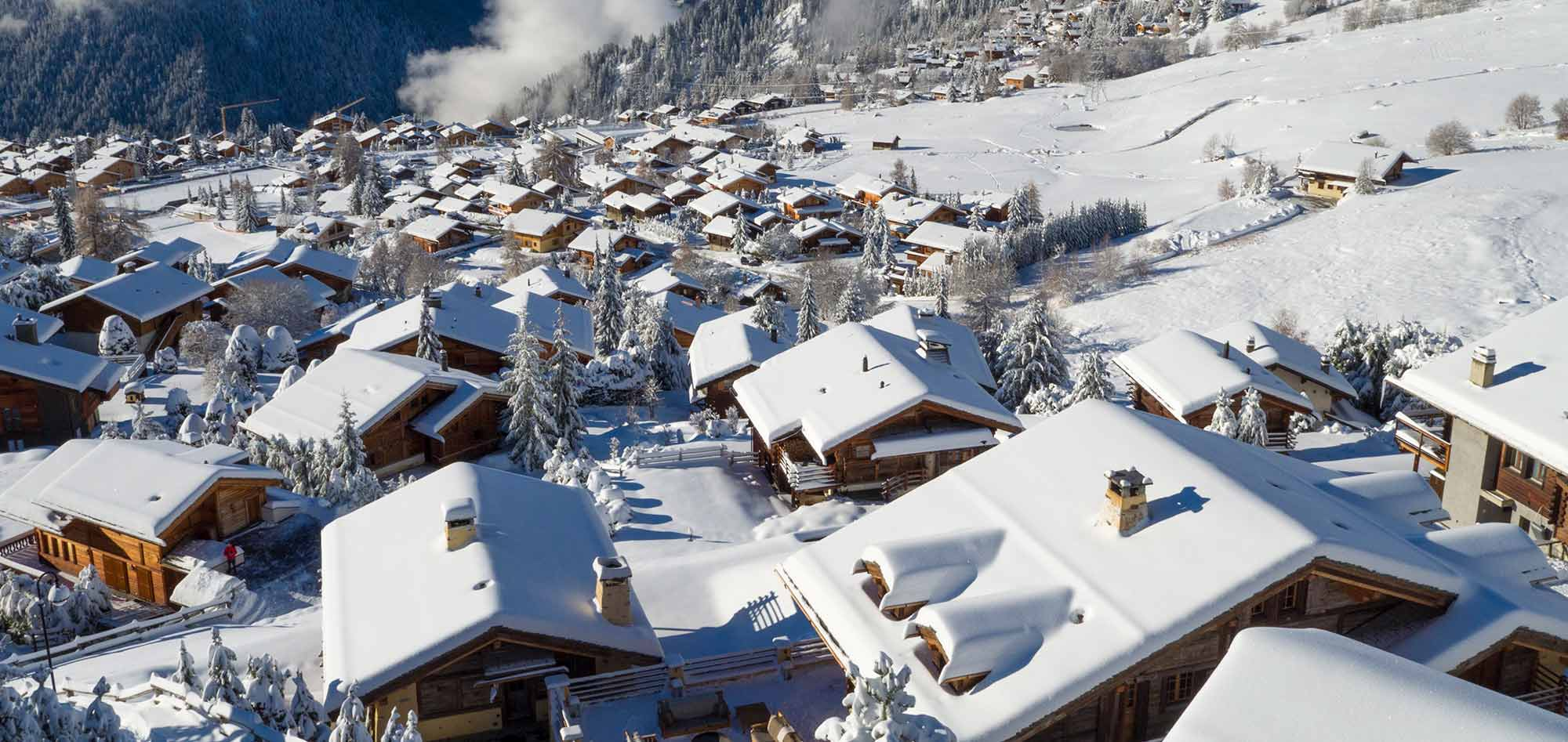 bird's-eye view of snow covered chalet rooftops