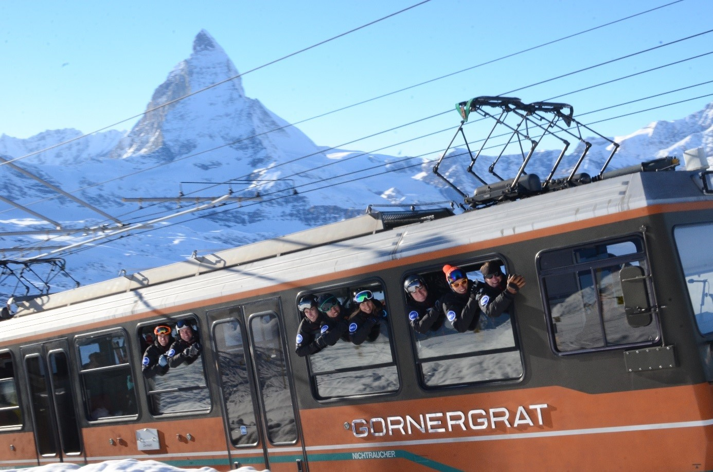European Snowsport riding Gornergrat train in Zermatt